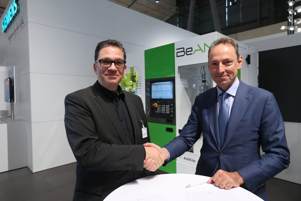 Uwe Ruttkamp, Head of Machine Tool Systems at Siemens Digital Industries and Vincent Gillet, CEO of BeAM.