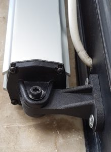 Fig. 4 New T-shaped attachment bracket mounted on the linear actuator