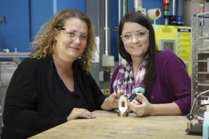 ORNL'S Bianca Haberl and Amy Elliot hold 3D Printed Collimators -- An Invention that has been licensed to Exone. (Genevieve Martin/Oak Ridge National Laboratory, US Dept. of Energy