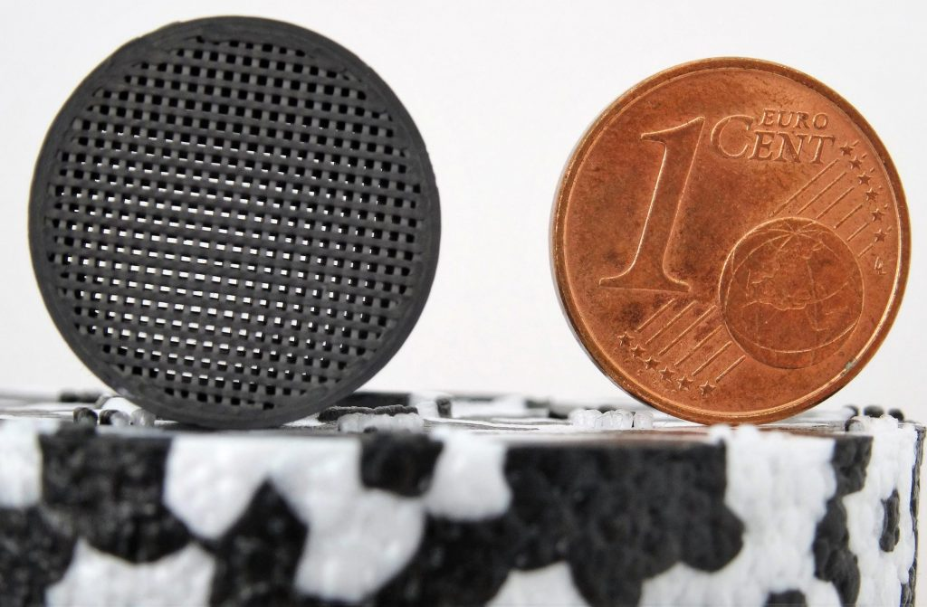 This filter – seen here with a euro cent coin for scale – has been produced in silicon carbide to a space standard of quality using nothing more than an off-the-shelf desktop 3D printer. Credit: TIWARI Scientific Instruments