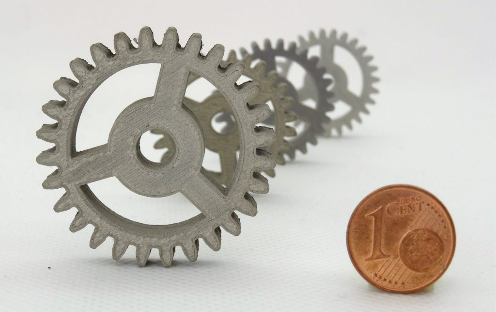 These spur gears – seen here with a euro cent coin for scale – have been produced in stainless steel to a space standard of quality using nothing more than an off-the-shelf desktop 3D printer. Credit: TIWARI Scientific Instruments